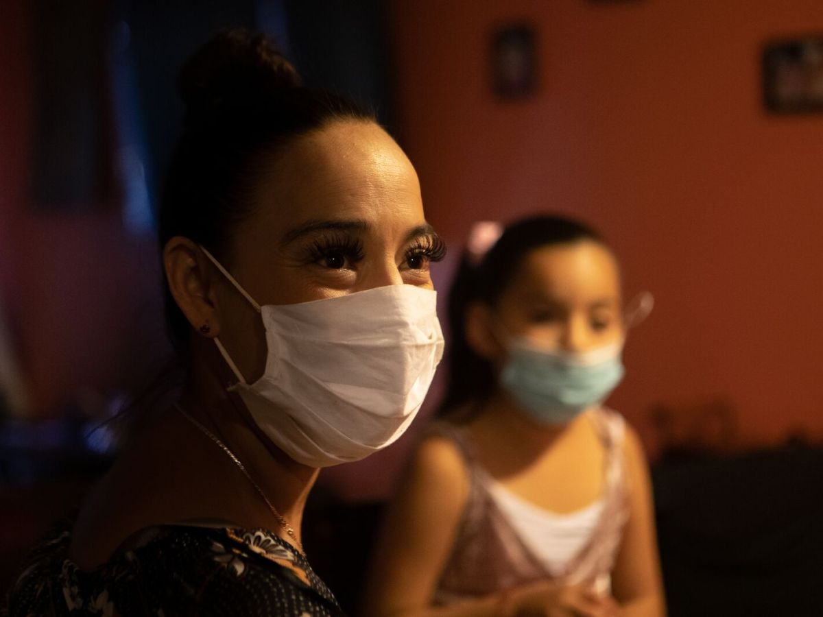 Guadalupe Muñoz with her daughter Carla in their East Oakland apartment. Mold and other problems have contributed to Carla's asthma.