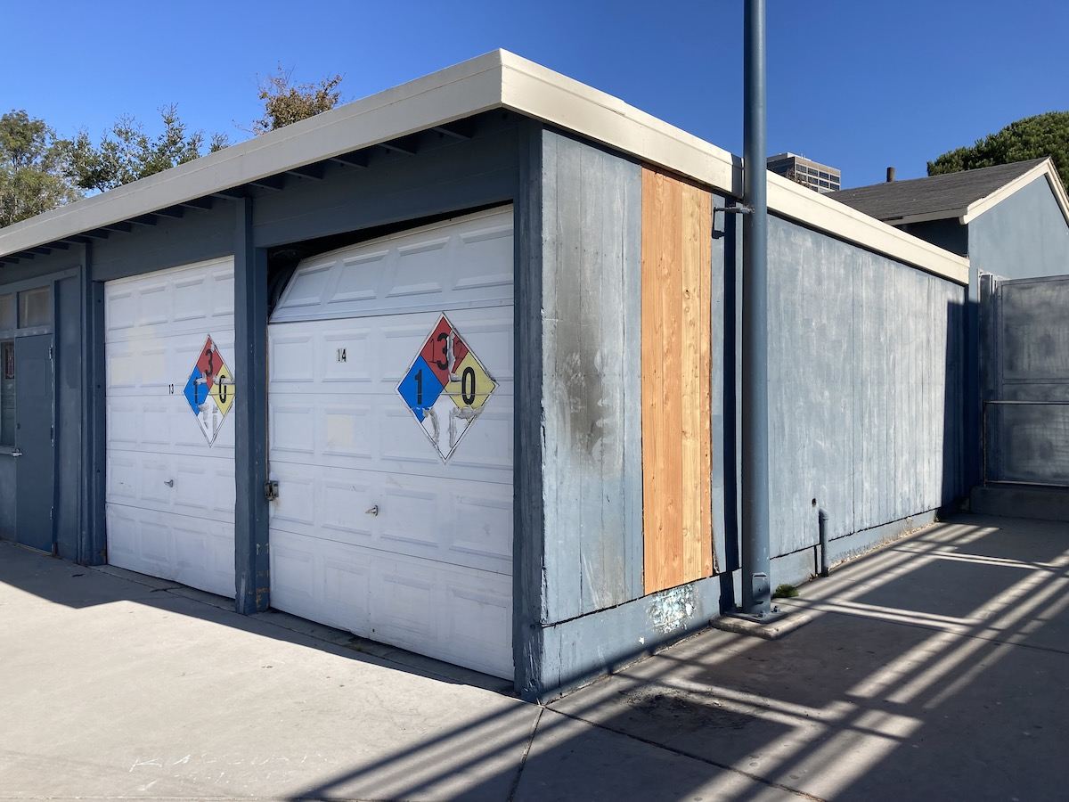 New plywood replaces the fire-damaged wall of a boat bay at the Lake Merritt Boathouse.