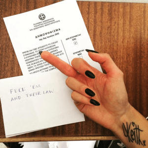 A Greek woman votes with her finger