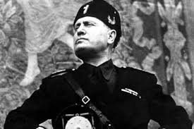 """The fascist Benito Mussolini: The Newsweek writer claims Trump is a fascist as was Mussolini. Although he shares some personality traits with Mussolini - the bragging, the extreme ego, etc. - Trump bases himself on different social forces. Whereas Mussolini gathered around him a gang of thugs who beat up and killed union activists, for instance, Trump is confined to the normal """"democratic"""" methods of legal maneuvering, firing union supporters, etc. The same difference is seen in the modern day world, where the Islamic State - a fascist force if there ever was one - rules through terror; Greece's Golden Dawn carries out organize attacks on the immigrant community; and the Israeli settler movement does the same against Palestinians while they call for """"death to (all) Arabs."""" While Trump undoubtedly has fascists of this type around him, the conditions are not ripe enough in the US for such a fascist movement on a wide scale."""