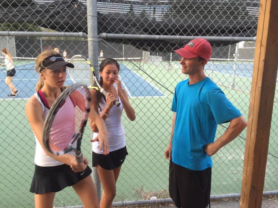 Coach Carl Joyce talks to students Savannah Gann and Sabrina Stone (Courtesy of Natalie Dobrinska).