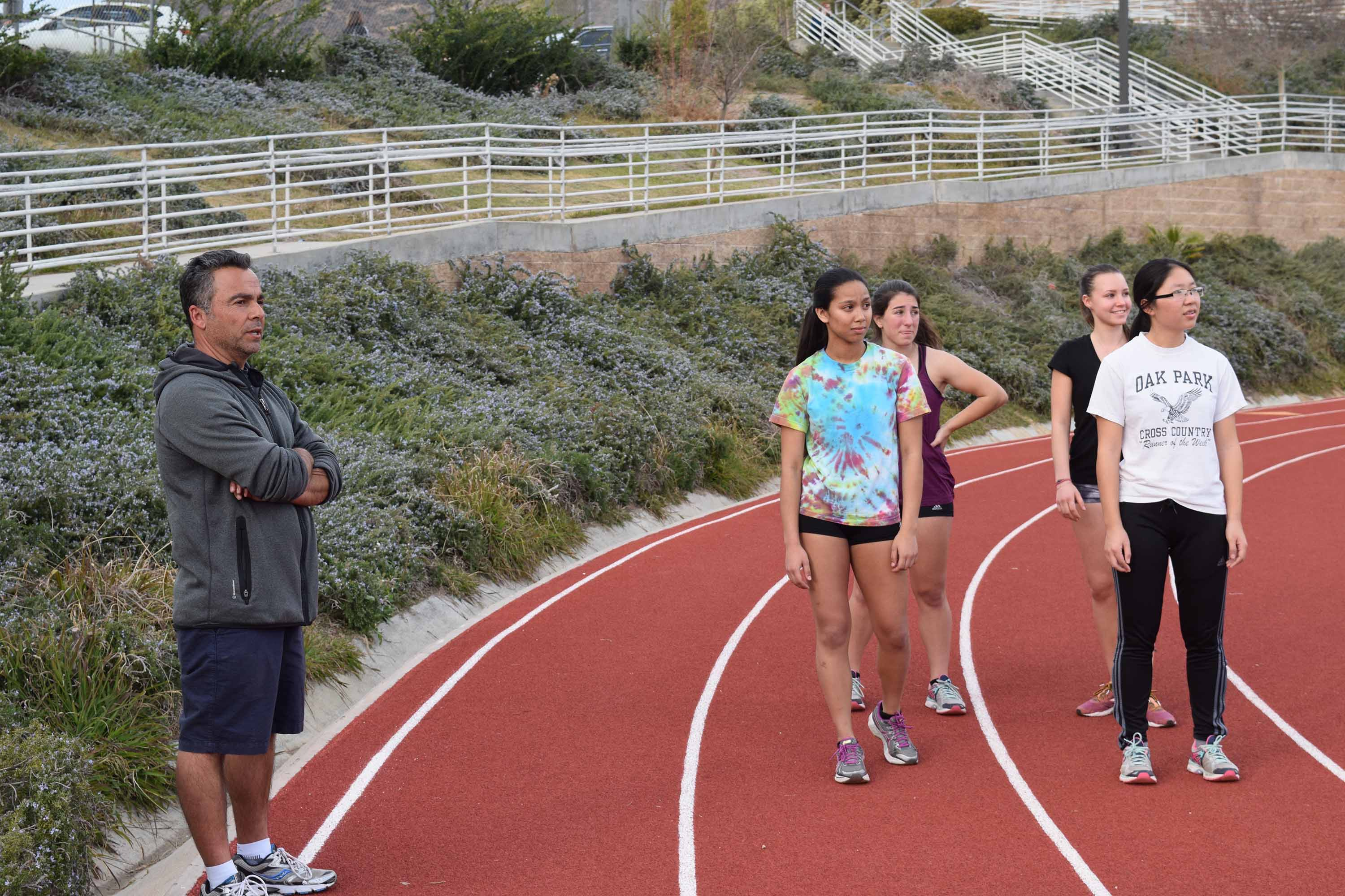 Track and cross-country Coach Al Calce talks to track runners during practice Jan. 27. After this season, Calce will be taking a break from coaching (Meghana Mudhunuri/Talon).