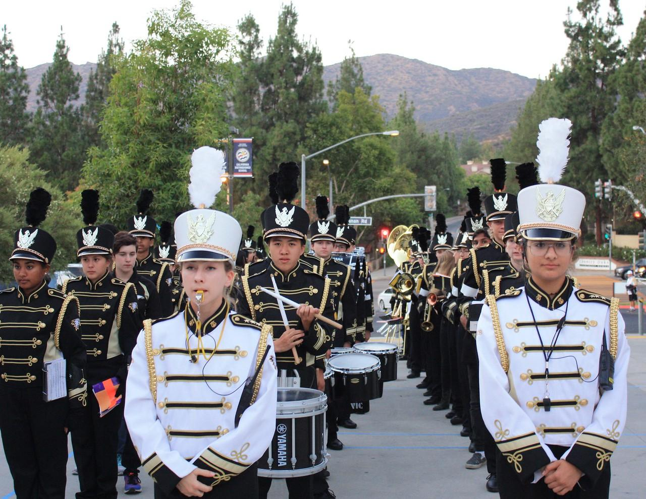 Students march in formation as part of Oak Park High School's marching band. Incoming freshmen joining marching band or cheer will be exempt from an otherwise mandatory physical education class (Meghana Mudunuri/Talon).