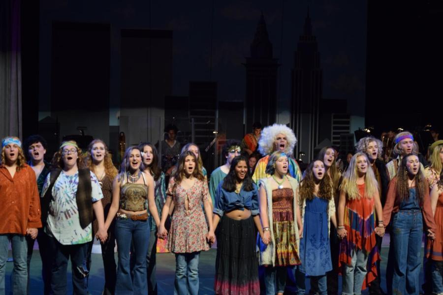 Students perform in the school theatre production of Hair March 16-18. The rock musical took place during the hippie movement addressing issues of love and the Vietnam war creating a song-filled production about unity (Nick Burt/Talon).