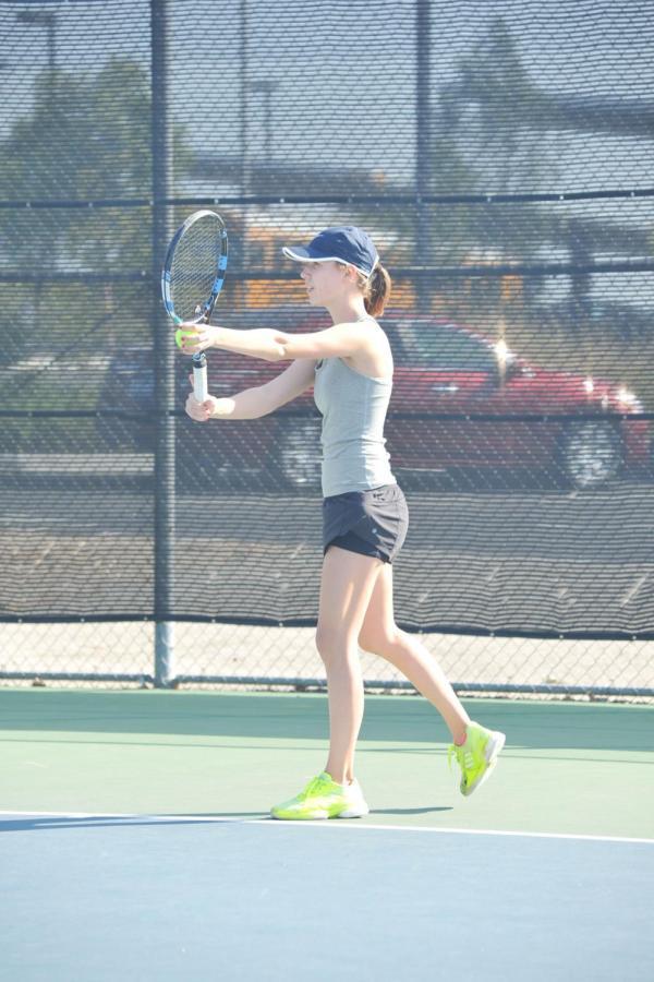 Junior Sylvie Van Cott playing tennis