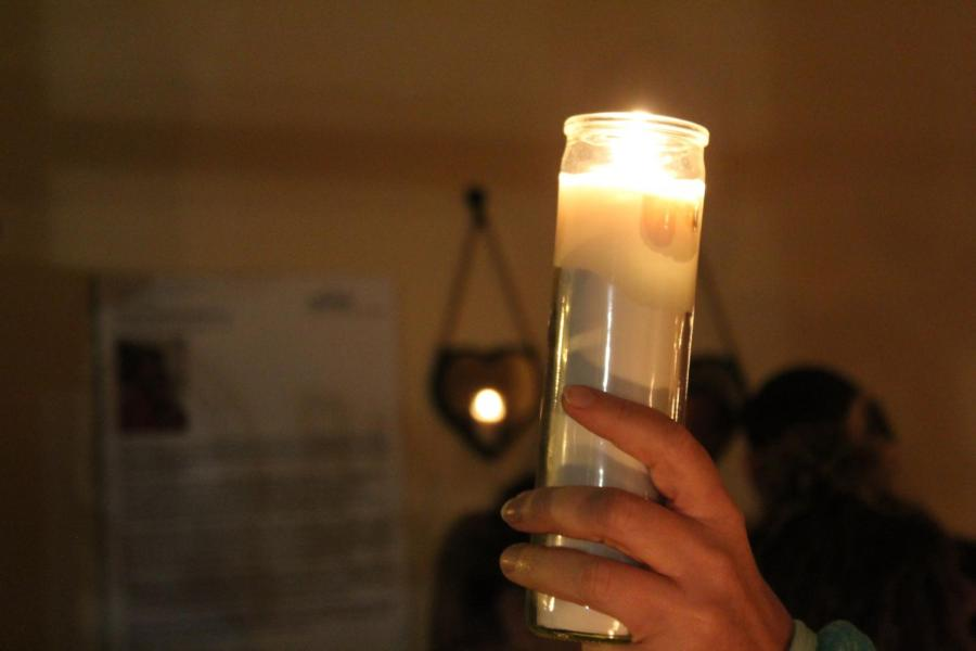 Community+members+gather+with+candlelight+the+night+after+a+bar+shooting+to+mourn+those+lost