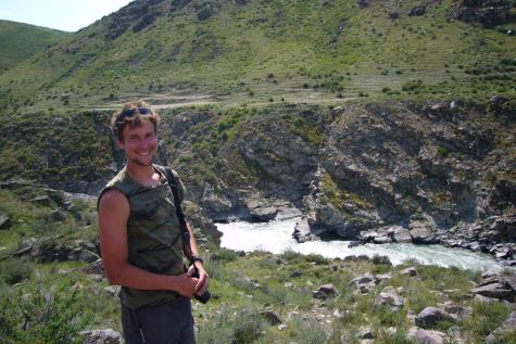 Taylor Hermes poses in southeasterm Kazakhstan at the Koksu River. Taylor's archeological efforts have brought him around the globe