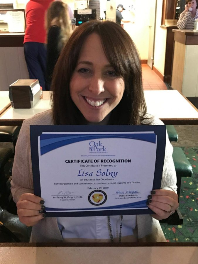 Lisa+Solny+poses+with+her+certificate+of+recognition+from+OPUSD+board+members.