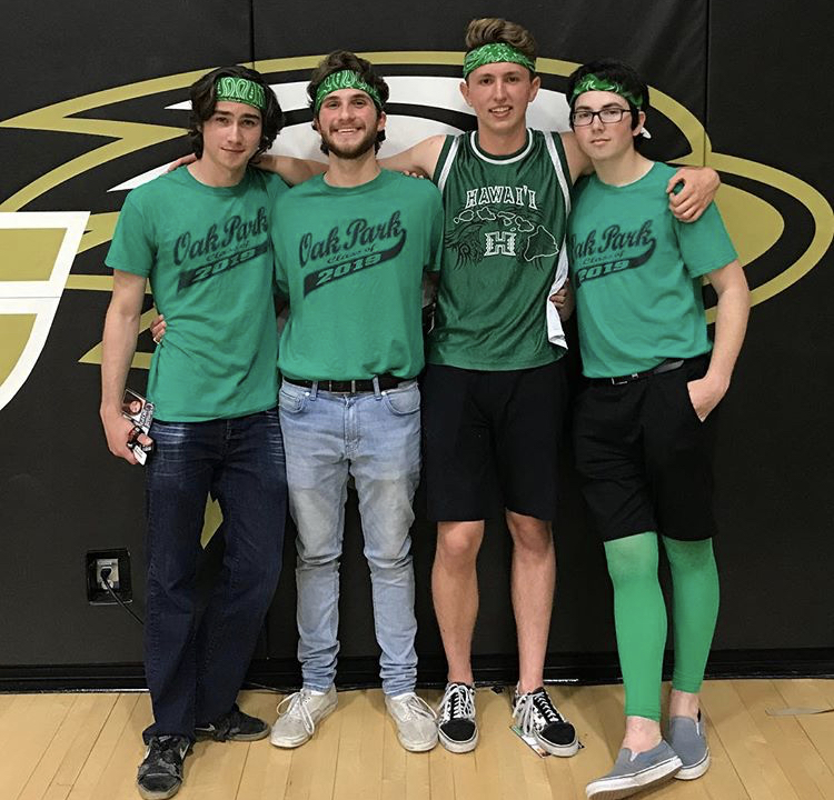 (Left to right) Seniors Ethan Martin, Aiden Glikkman, Dylan Rodgers and Ben Fuller dressed in green for their last rally at Oak Park High School.
