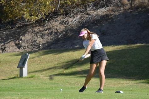 Junior Catherine Riker takes a swing at the sixth hole.