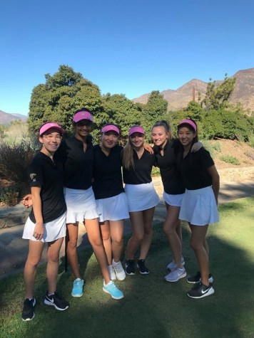 The girl's golf team poses happily during league finals, where they placed second.