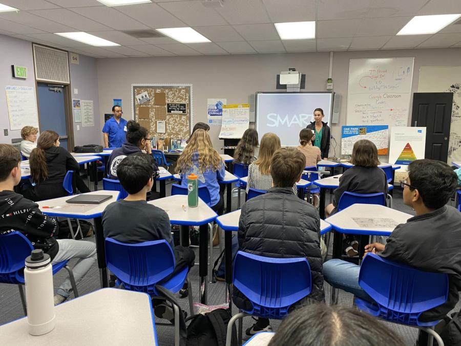Presenters from the ADL speak to English II Honors students about checking one's own biases through role playing and various other techniques.