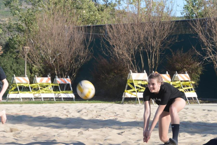 On+an+ordinary+Tuesday+practice%2C+Payton+dives+to+save+a+ball+from+a+sandy+embrace.+Payton%E2%80%99s+athleticism+allowed+her+to+quickly+adjust+to+her+new+sport