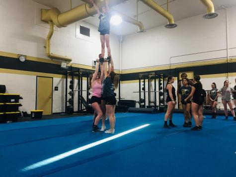 Stunt teams practices lifts and routines for upcoming competition.