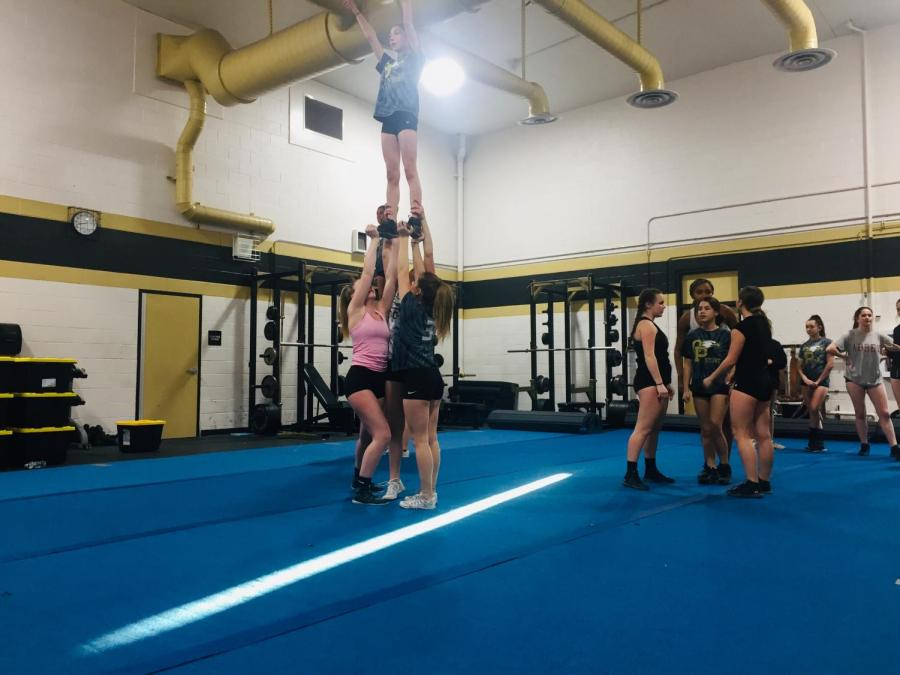 Stunt+teams+practices+lifts+and+routines+for+upcoming+competition.