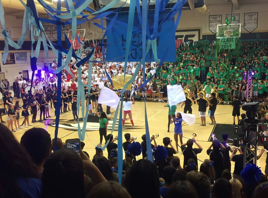 Color+Guard+and+band+performing+at+an+OPHS+student+rally.