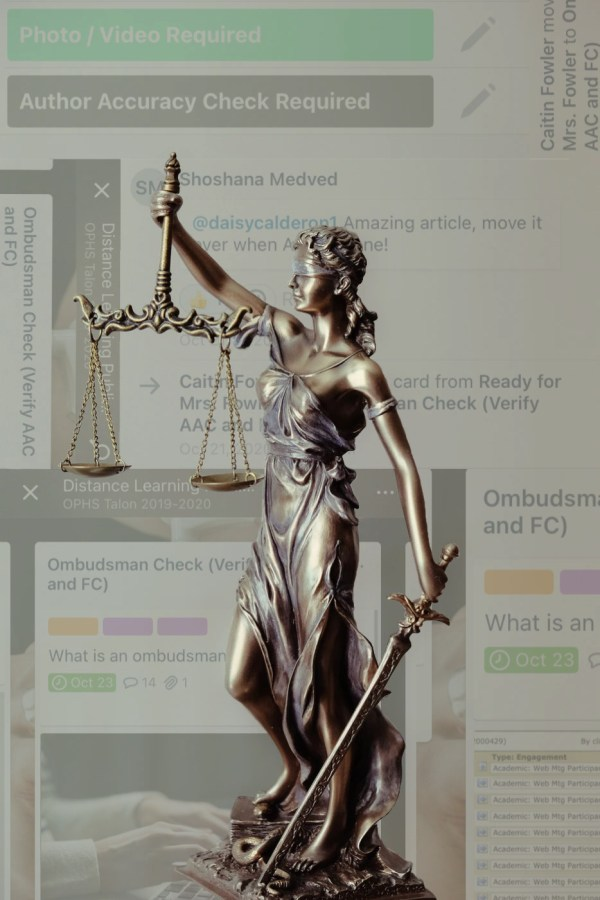 Lady Justice stands in front of Talon articles on the Trello communication board. Trello has been the platform to edit and review all Talon stories.