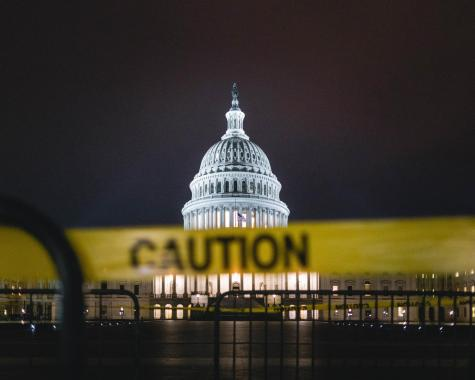The Capitol building stands surrounded by yellow caution tape at a date prior to the Jan. 6 breach. As of 3:30 p.m. EST, all rioters had been removed from the Senate floor, and by 9:30 p.m., 52 arrests had been made. (Photo courtesy of Andy Feliciotti/Unsplash)