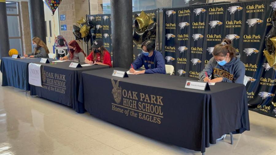 OPHS athletes sign papers celebrating their college acceptances. Senior players participated in this event on Signing Day, held April 26th.