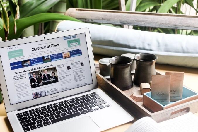 Newspaper on laptop Image