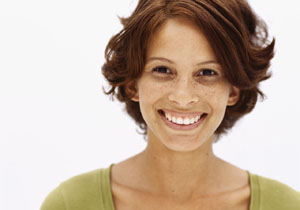 portrait of a young woman smiling --- Image by © Royalty-Free/Corbis
