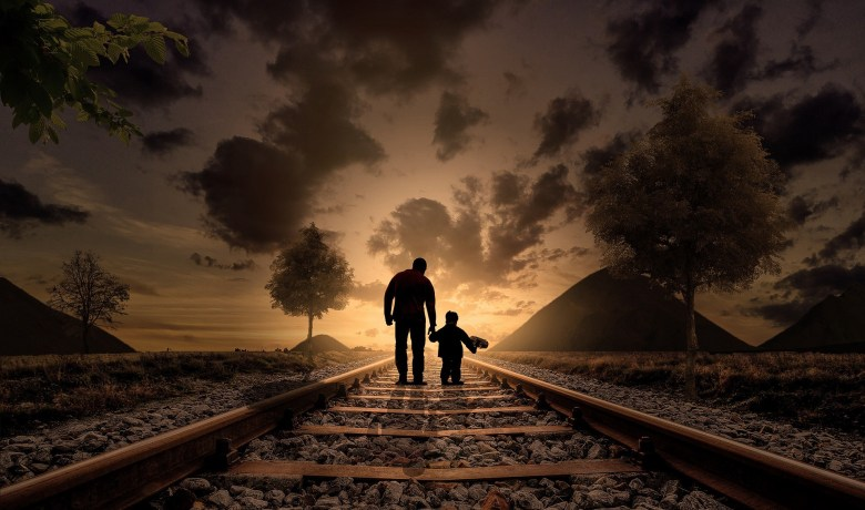Father and Son on Railroad Track.jpeg