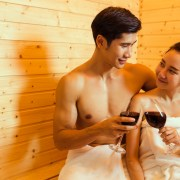 Happy couple relaxing in the sauna at Oasis Aqualounge