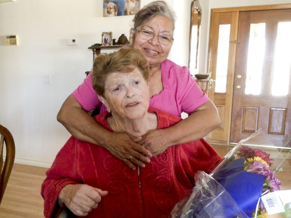 Female caregiver hugging female Senior client