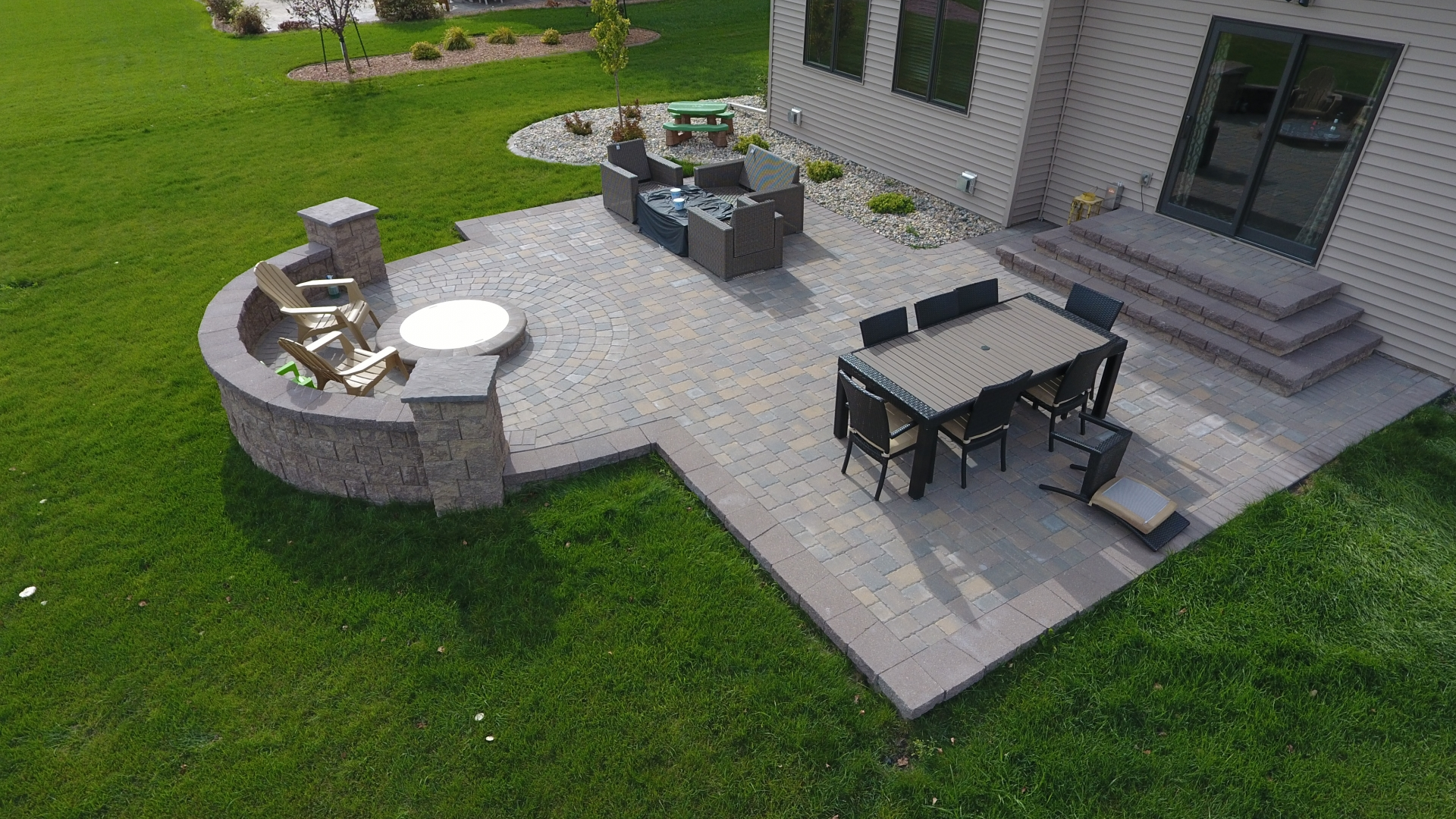 backyard fire pit with seat wall and