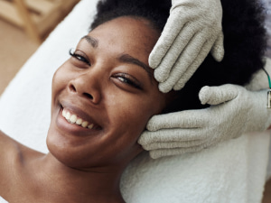 Happy customer after a hydrofacial procedure