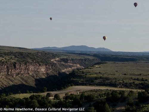 Hot air balloons over the Rio Grande River gorge.