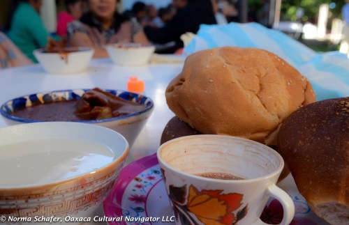 Breakfast hot chocolate, atole, chicken, mole amarillo and sweet bread.