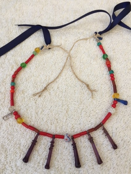 """This 14"""" strand came in on turquoise embroidery floss. The short brown beads are old."""