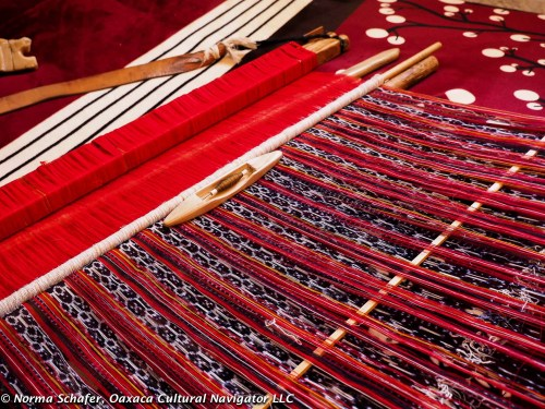 On the backstrap loom, a stunning red, black and white ikat rebozo by Evaristo Borboa