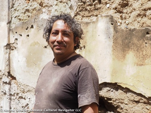 "Gabriel ""Gabo"" Mendoza Rodriguez in front of colonial adobe wall"