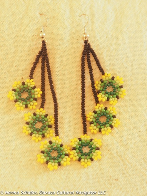 "Huichol hand beaded earrings. 3"" long. $28 USD"