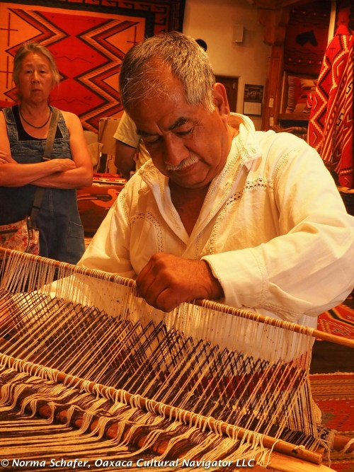 Arturo demonstrates back-strap loom weaving at Malouf's on the Plaza