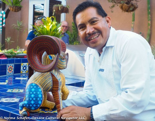Jacobo Angeles with copal wood carved and painted ram from San Martin Tilcajete, Oaxaca