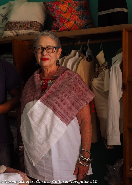 I'm modeling an innovative two-tone huipil from Pedro Martin textile workshop
