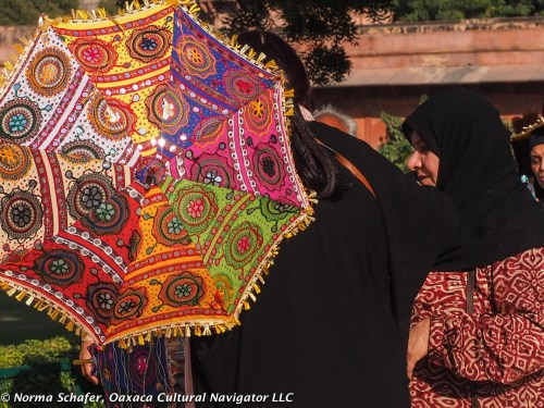 Moslem women protect themselves from the sun.