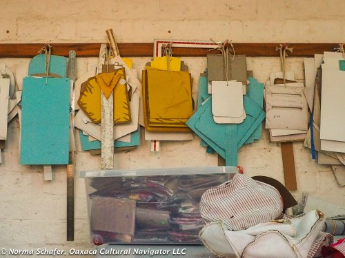 Bag patterns hang in small workshop space