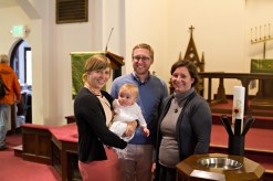 With her Godparents, Erica, Colleen, and Brad.