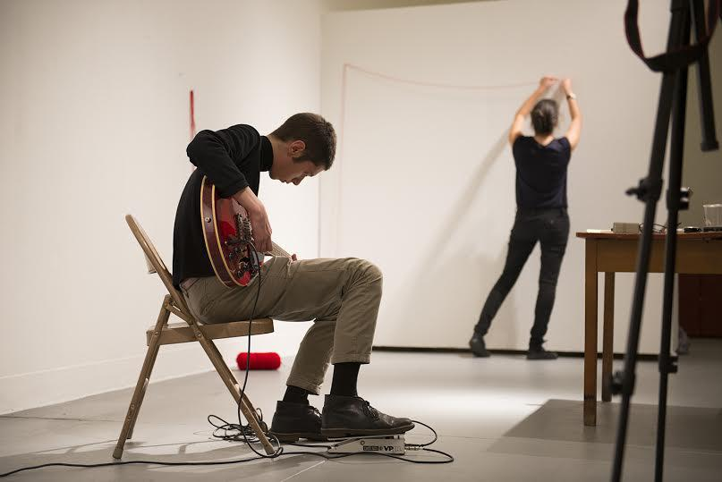 Conservatory junior Sivan Silver-Swartz improvises on electric guitar as College senior Katie Rotman creates an improvised string installation.