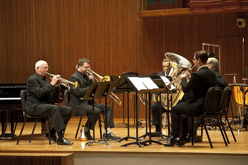 A+brass+quintet+performs+Lutos%C5%82awski%E2%80%99s+%E2%80%9CMini+Overture%E2%80%9D+in+Warner+Concert+Hall.+Associate+Professor+of+Trumpet+Roy+Poper+%28left%29%2C+Assistant+Professor+of+Trombone+Lee+Allen%2C+Visiting+Professor+of+Tuba+Denis+Nulty%2C+Professor+of+Horn+Roland+Pandolfi+and+Trumpet+major+and+Conservatory+senior+Luke+Spence+played+with+precision+and+poise+during+this+installment+of+the+Faculty+Chamber+Series.