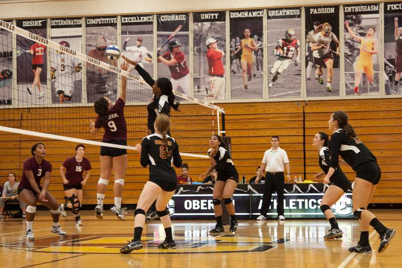 Sophomore middle hitter Dana Thomas spikes the ball over Earlham College's Abigail Sheehan. Thomas had seven kills and two blocks as the Yeowomen beat the Quakers 3–1 this past Saturday. Oberlin was subsequently defeated by Hiram College this past Wednesday and is currently 6–8 overall and 2–1 in conference.