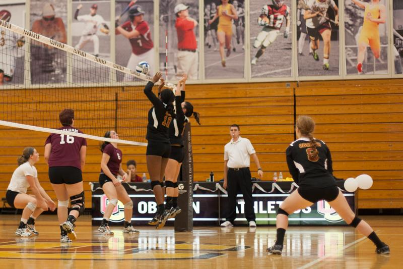 Sophomore+middle+hitter+Dana+Thomas+and+junior+setter+Meredith+Leung+leap+to+block+a+hit+during+their+game+against+Earlham+College+on+Sep.+26.+The+Yeowomen+won+the+match+3%E2%80%931+and+concluded+their+season+this+weekend%2C+finishing+2%E2%80%936+in+conference+and+8%E2%80%9319+overall.+
