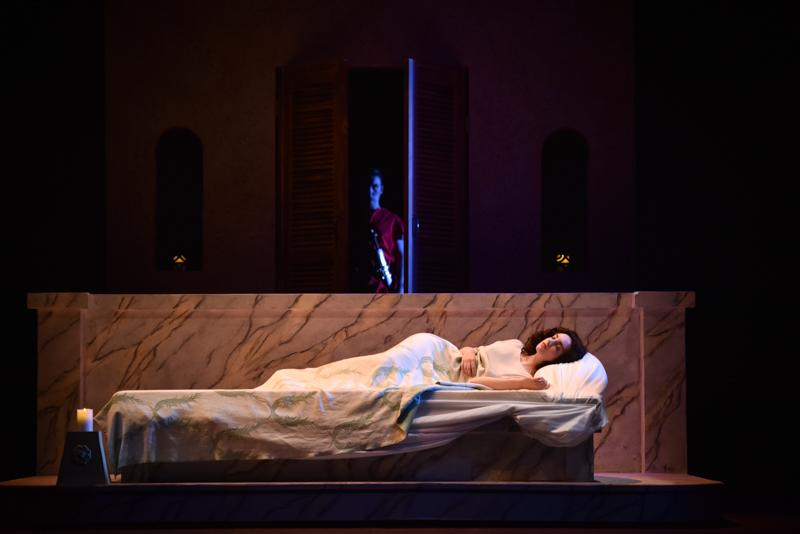 As+Lucretia%2C+Conservatory+senior+Rebecca+Printz+rests+while+Tarquinius%2C+played+by+Conservatory+senior+Michael+Floriano%2C+lurks+in+a+doorway.+%27The+Rape+of+Lucretia%2C%27+performed+Nov.+11%2C+13%2C+14+and+15+by+Oberlin+Opera+Theater+and+the+Contemporary+Music+Ensemble%2C+uses+sexual+violence+against+the+title+character+as+a+metaphor+for+the+destruction+of+Western+Europe+during+World+War+II.