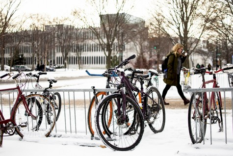 A student walks past bikes locked to a rack outside the King Building. The Oberlin Police Department is launching a new safety initiative that aims to reduce the city's traffic violations.