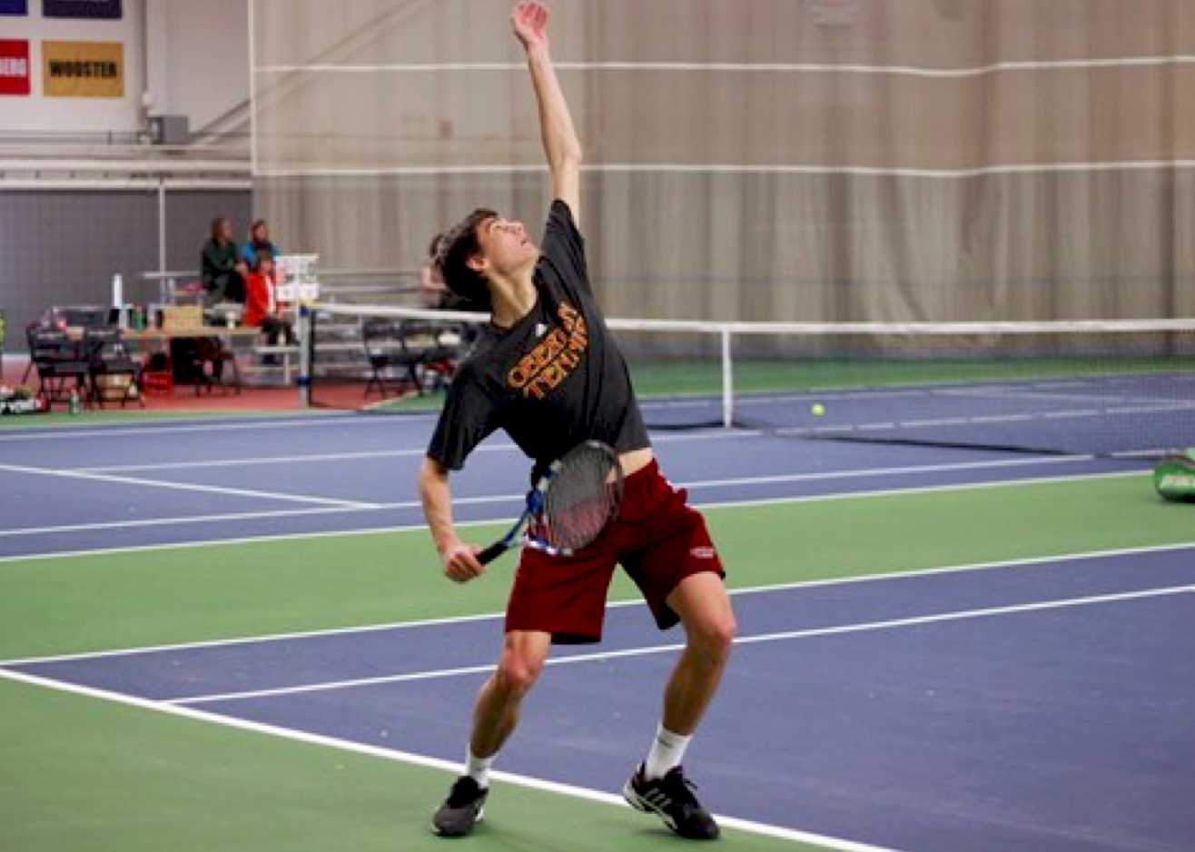 Junior Abe Davis lofts the ball up to serve to Fernando Sousa and Mikel Oscoz of Indiana Tech Saturday. Davis and his senior partner Callan Louis defeated their Indiana Tech opponents 8–5 in doubles action, and the duo each earned wins in singles play to contribute to the Yeomen's 6–3 win in the afternoon.