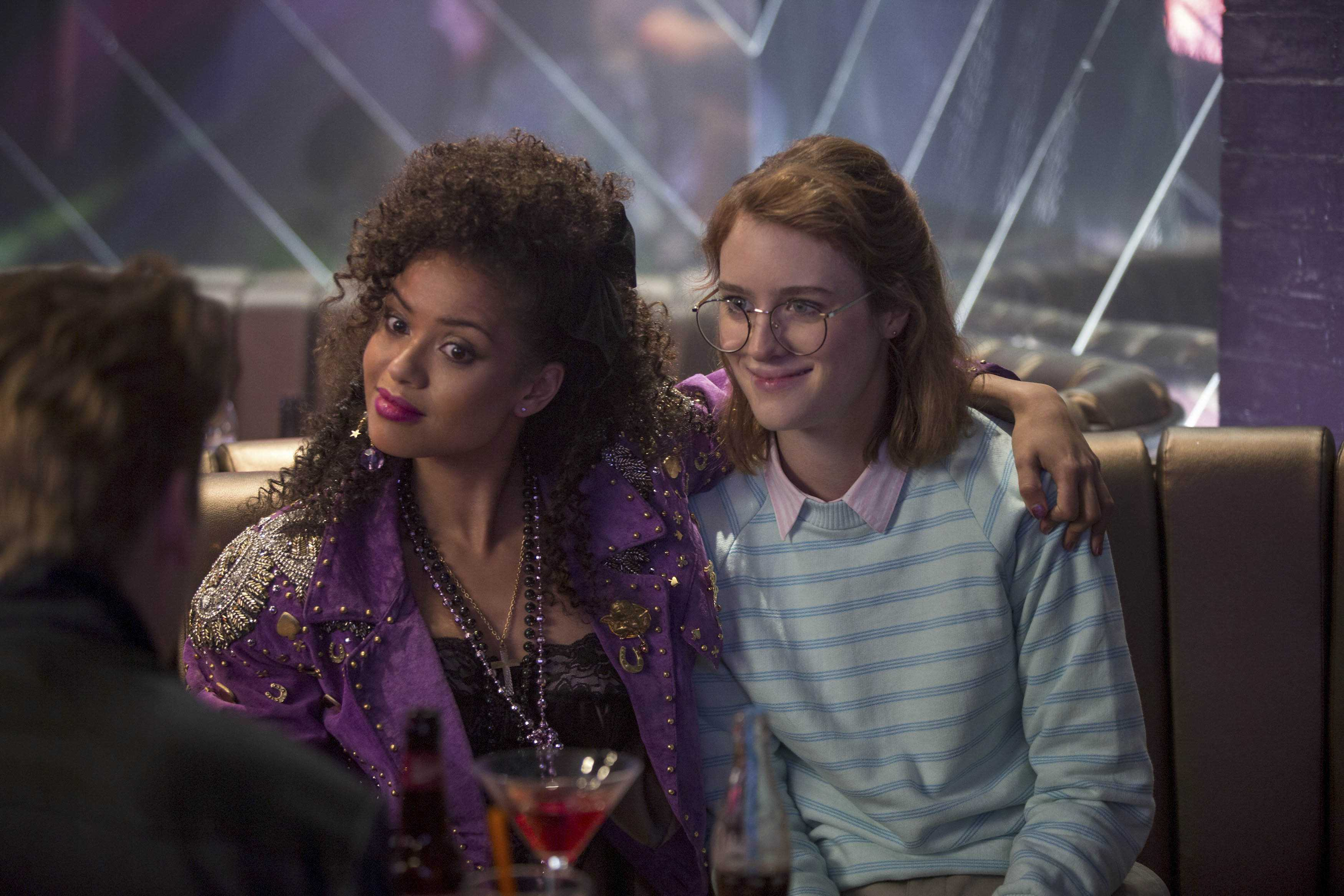 "Characters Kelly (Gugu Mbatha-Raw, left) and Yorkie (Mackenzie Davis, right) begin a relationship that will undergo the test of time in ""San Junipero,"" the fourth of six new episodes in season three of Netflix's Black Mirror."